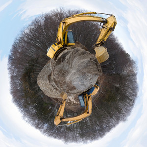 A panoramic view of a construction site with large earth movers.