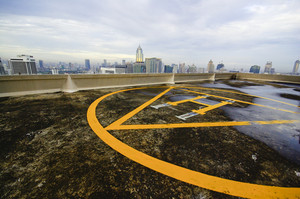 A peak helipad under sunrise