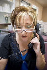 A phone receptionist scheduling appointments in a beauty salon.  This could also be a doctor's office.