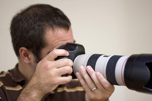A photographer shooting with a telephoto lens.  Shallow depth of field.
