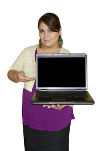 A plus size model presenting something on a laptop. Clipping paths are included for the girl as well as the screen to insert your own image.