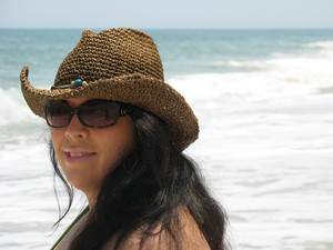 A pretty Spanish model smiling at the beach - Assateague Island, located near Ocean City, Maryland.  Plenty of copy space.