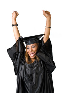 A recent graduate posing in her cap and gown isolated over white. Clipping path included.