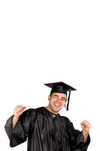 A recent graduate posing in his cap and gown and celebrating.  Isolated over a white background with negative space above the model.