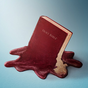 A red Bible melts into a puddle