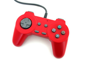 a red video game controller isolated over a white background