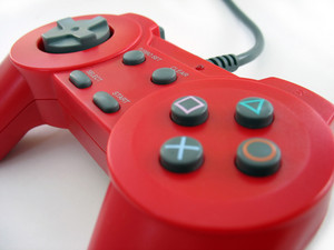 a red video game controller isolated over white
