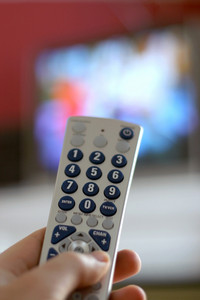 A remote control in action - shallow depth of field, with focus on the remote.