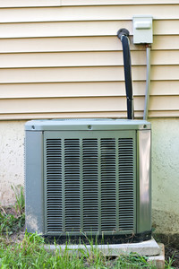 A residential central air conditioning unit sitting outside a home.