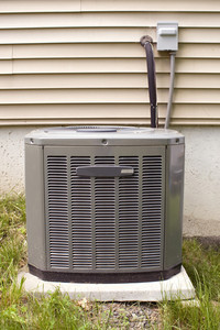 A residential central air conditioning unit sitting outside.