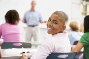 A schoolboy in a high school class