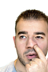 A shot of a man digging for gold - the nose picker.