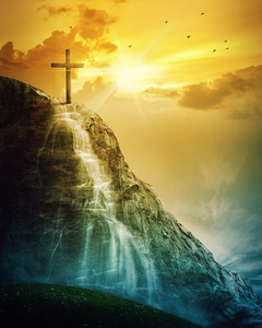 A single cross on a mountain with a waterfall