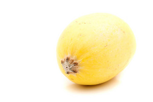 A single golden yellow spaghetti squash isolated over a white background.