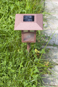 A solar powered garden lamp - these save electricity and are very eco friendly.