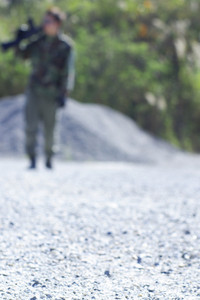 A soldier at work focus on front of road