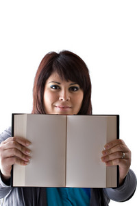 A twenties plus size model holding up a book with blank pages and copyspace.