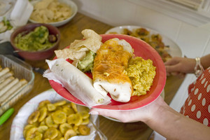 A variety of Mexican food on a plate.