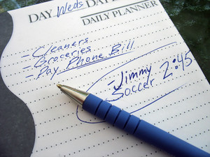a very busy schedule - written out on a daily planner