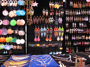 A very colorful assortment of jewelry on display.  Many of these are isolated nicely over black, and can be cut out very easily.