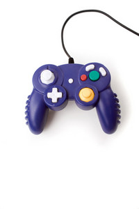 A video game controller game pad isolated over white.