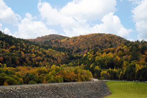 A view of colorful mountain full of bright fall foliage in Vermont.