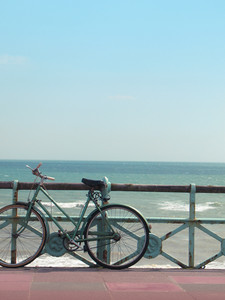 A Vintage Beach Bike Against Turquoise Sea.