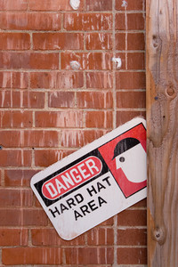 A warning sign that reads DANGER HARD HAT AREA.
