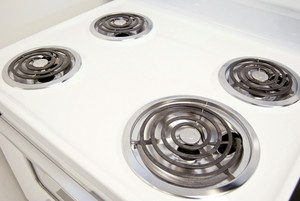 A white electric stove with four burners.