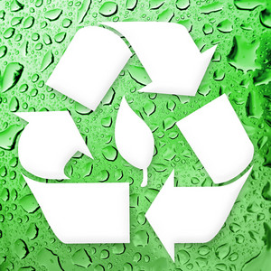 A white recycling symbol over a water droplets background.  Great for going green!