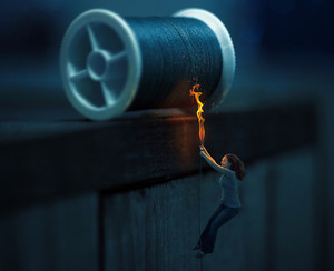 A woman hanging by a thread on fire.