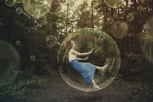 A woman is falling and stuck inside a bubble