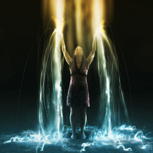 A woman lifts up her arms and feels the light pouring down
