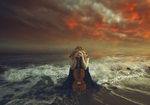 A woman prays with her violin at dusk.