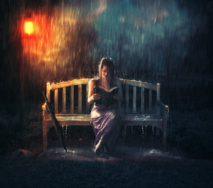A woman read her Bible alone in a rain storm.