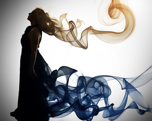 A woman walks away with smoke vapor