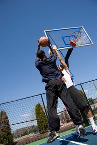 A young basketball player going for a jump shot.