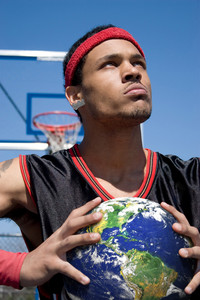 A young basketball player gripping the earth tightly.