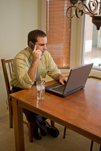 A young business man working from home with his laptop.
