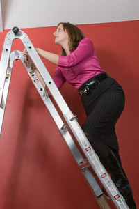 A young business woman rising to the top of this symbolic corporate ladder.