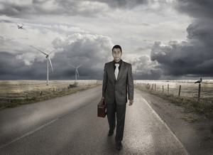 A young businessman walking on the road
