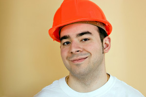 A young construction professional smiling with copy space.