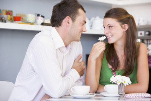 A young couple enjoying tea together