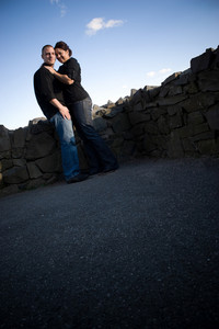 A young happy couple in a loving embrace outdoors with copy space.