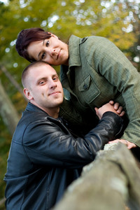 A young happy couple outdoors in a rural country setting.
