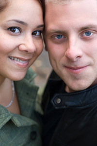 A young happy couple with their heads close together.