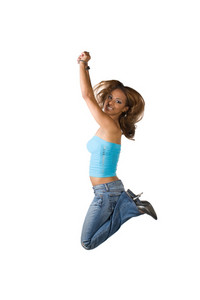 A young Latina woman jumping in the air with her knees bent isolated over a white background.
