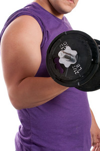 A young man lifting a dumbbell over a white background.
