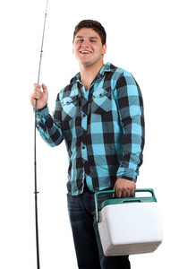 A young man poses with his fishing reel and beer cooler isolated over white in studio with negative space.