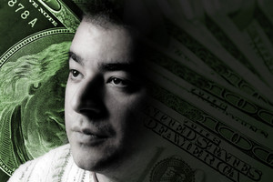 A young man with money on his mind.  A great image to illustrate unemployment or stock investments.